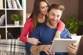 Couple enjoying free internet at home — Stock Photo