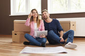 Couple planning their new apartment — Stock Photo