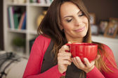 Woman enjoying the smell of coffee — Stock Photo