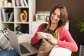 Woman relaxing with modern technology — Stock Photo