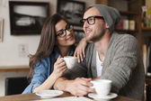 Man and woman in cafe — Stockfoto