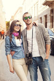 Hipster couple in city — Stock fotografie