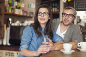 Hipster couple talking with friends — Stock Photo