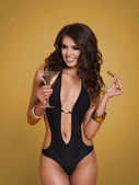 Woman in swimwear drinking martini — Stock Photo