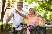 Couple with bicycles in park — Stock Photo