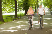 Couple relaxing by riding on the bike — Stock Photo