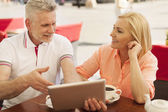 Couple enjoying the wireless internet — Stock Photo