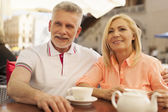 Mature couple at restaurant — Stock Photo
