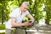 Mature  man using mobile phone — Stock Photo
