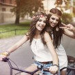 Boho girls on the tandem bicycle — Stock Photo #48592221