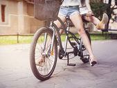 Girls  riding tandem bike — Stock Photo