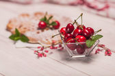 Robust cherries with fresh waffles — Stock Photo