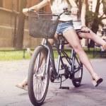 Boho girls legs during riding tandem bike — Stock Photo #49931699