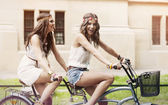 Women have fun on riding a tandem — Stock Photo