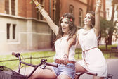 Boho girls cycling — Stock Photo
