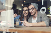 Couple have fun at cafe — Stock Photo