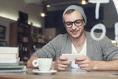 Hipster man with mobile phone — Stock Photo