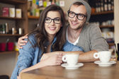 Embracing couple  at cafe — Stock Photo