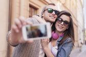 Loving couple taking selfie — Stock Photo
