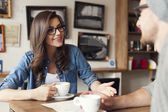 Hipster couple talking at cafe — Stock Photo