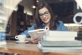 Hipster woman studying at cafe — Stock Photo