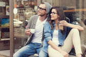 Stylish couple at outside of cafe — Stock Photo