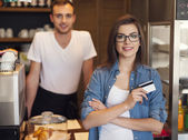 Smiling waiter and beautiful female customer — Foto Stock