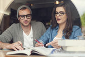 Young couple studying together — Stock Photo