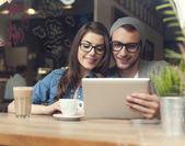 Couple enjoying wireless internet — Stock Photo