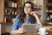Woman using digital tablet — Stock Photo