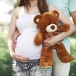 Future parents with teddy bear — Stock Photo #50926227