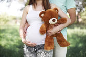 Future parents with teddy bear — Stock Photo
