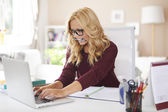 Teenager hard working at home — Stock Photo