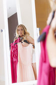 Woman choosing dress — Stock Photo
