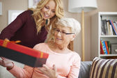 Surprise for sweetheart grandma — Stock Photo