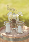 Lovely candles in jars — Stock Photo