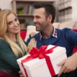 Couple on Christmas time with gifts — Stock Photo #51644469