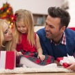 Young family on Christmas time — Stock Photo #51644549