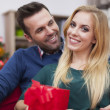 Couple on Christmas time with gifts — Stock Photo #51644977