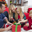Happy family during Christmas time — Stock Photo #51645529