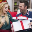 Man gives present to woman — Stock Photo #51646449