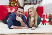 Couple on Christmas time with gifts — Stock Photo