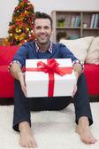 Man with Christmas present — Stock Photo
