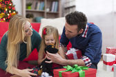 Young family on Christmas time — Stock Photo