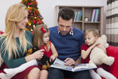 Happy family during Christmas time — Stock Photo
