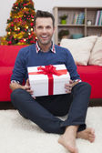 Man with Christmas present — Stock Photo