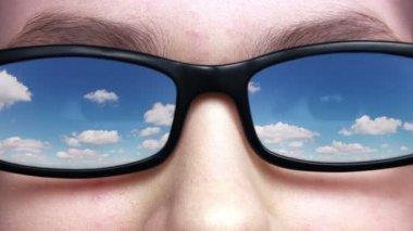 Sky reflected in glasses — Stock Video