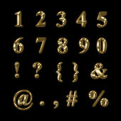 Gold numbers, punctuation and symbols — Stock Photo