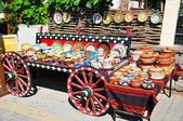 Souvenirs on a wooden carriage. — Stock Photo