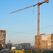 Building crane on the background of blue sky — Stock Photo
